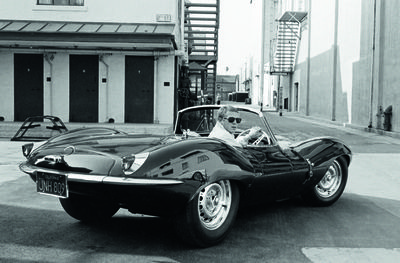 11. Steve McQueen in black jaguar at studio