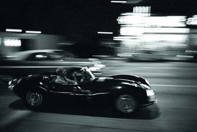 8. Steve McQueen driving his Jaguar XK-SS on Sunset Blvd.